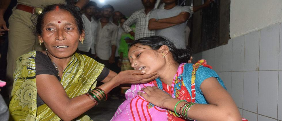 Relatives mourn the death of a children at Baba Raghav Das Hospital in Gorakhpur district of the Indian northern state Uttar Pradesh on August 11, 2017.