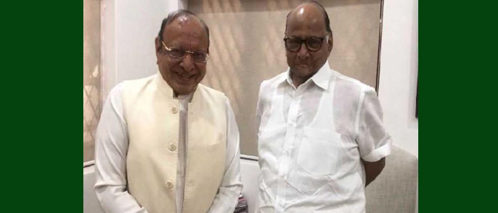 Former Guj CM Vaghela joins NCP in presence of Sharad Pawar