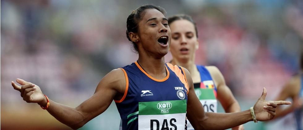 Hima Das celebrates her victory in women's 400 meter race at the 2018 IAAF World U20 Championships in Tampere, Finland, Thursday, July 12, 2018. AP/PTI