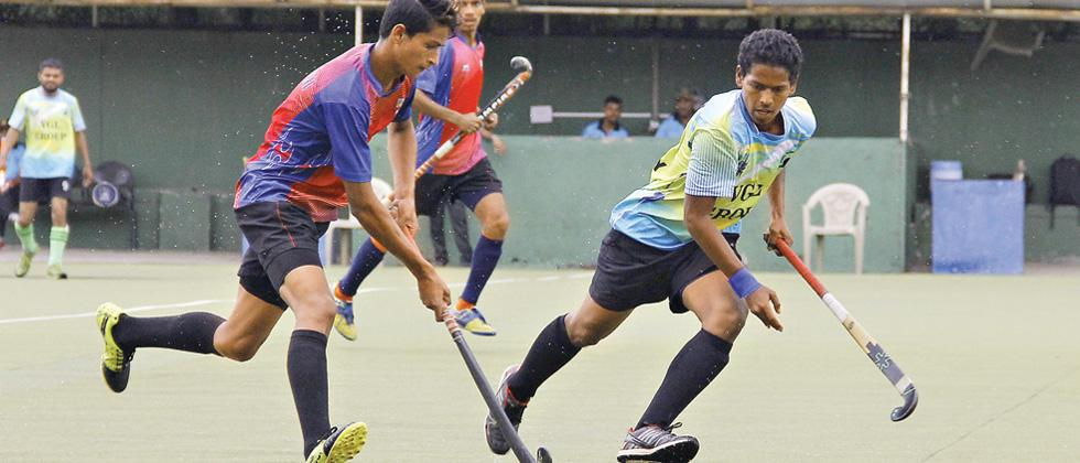 Players of Krida Prabodhini (red and blue) in action against PCMC XI at the Major Dhyan Chand Poligras stadium, Pimpri on Wednesday.