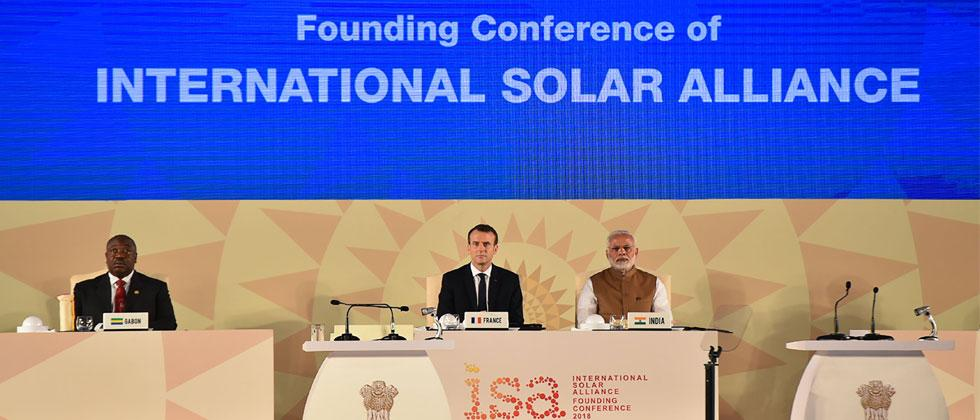 Handout photo released by the Indian Ministry of External Affairs shows Prime Minister Narendra Modi and French President Emmanuel Macron attending the founding conference of the International Solar Alliance. Photo/Indian MEA/AFP