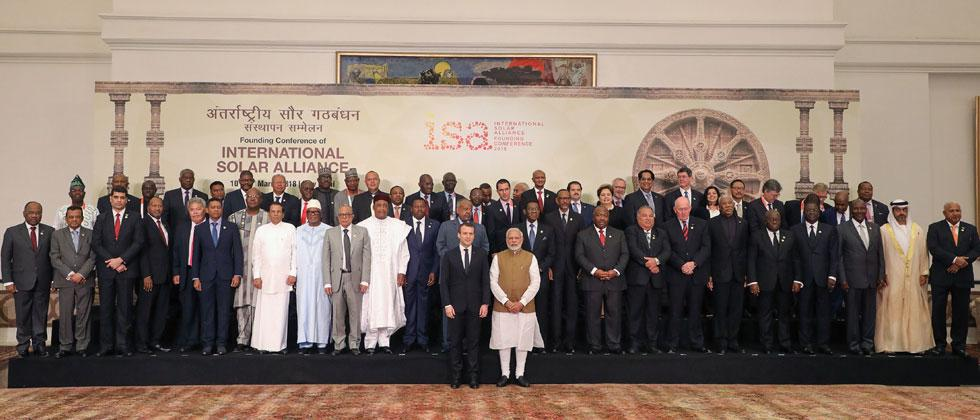 Prime Minister Narendra Modi and French President Emmanuel Macron pose with world leaders and representatives for a group picture at the start of the founding conference of the International Solar Alliance. Photo Marin Ludovic/AFP