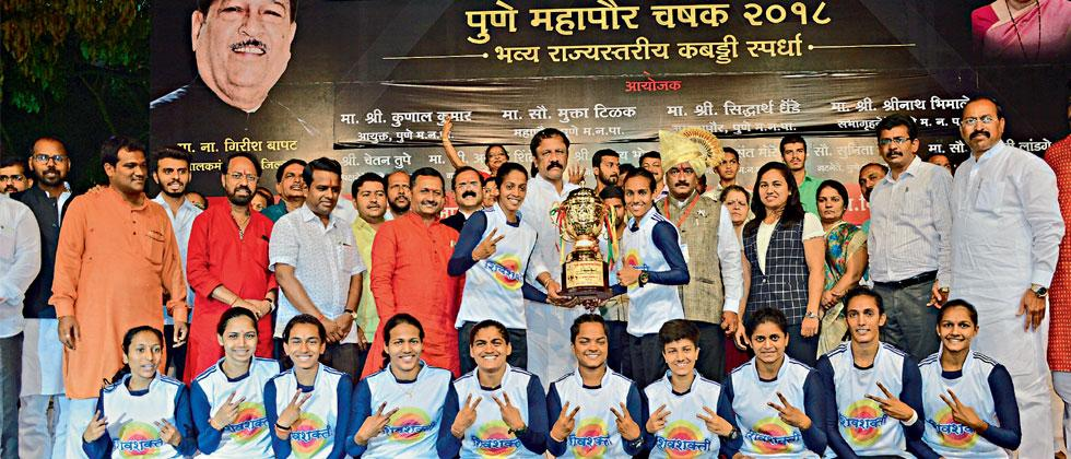 Mumbai's Shivshakti Club girls team celebrate with trophy with dignitaries including Baner's corporator Baburao Chandere