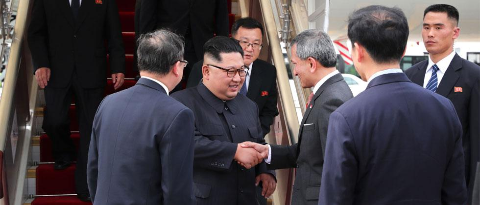 Handout photo taken by Ministry of Communications & Information of Singapore shows North Korean leader Kim Jong Un being welcomed by Singapore's Foreign Minister Vivian Balakrishnan. Terance Tan/AFP/Ministry of Communications & Information of Singapore