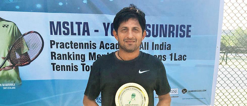 Nitten Kirrtane poses with the trophy after winning AITA National Ranking tournament in Mumbai