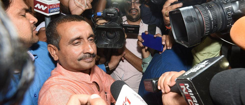 BJP MLA from Unnao Kuldip Singh Sengar, accused in a rape case, surrounded by media persons outside the office of the Senior Superintendent of Police in Lucknow on Wednesday night. Nand Kumar/PTI
