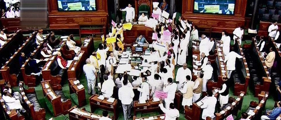 Opposition members protest during the ongoing budget session of Parliament at the Lok Sabha in New Delhi on Monday. PTI Photo/TV GRAB
