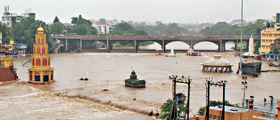 The Godavari river was flooded due to heavy rains in Nashik on Friday. (Pic: Maitreyee Ambade)