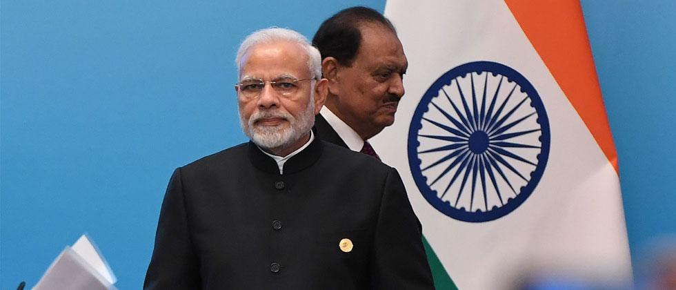 Pakistan's President Mamnoon Hussain walks past India's Prime Minister Narendra Modi as they arrive for a signing ceremony during the Shanghai Cooperation Organisation Summit in Qingdao. Wang Zhao/AFP