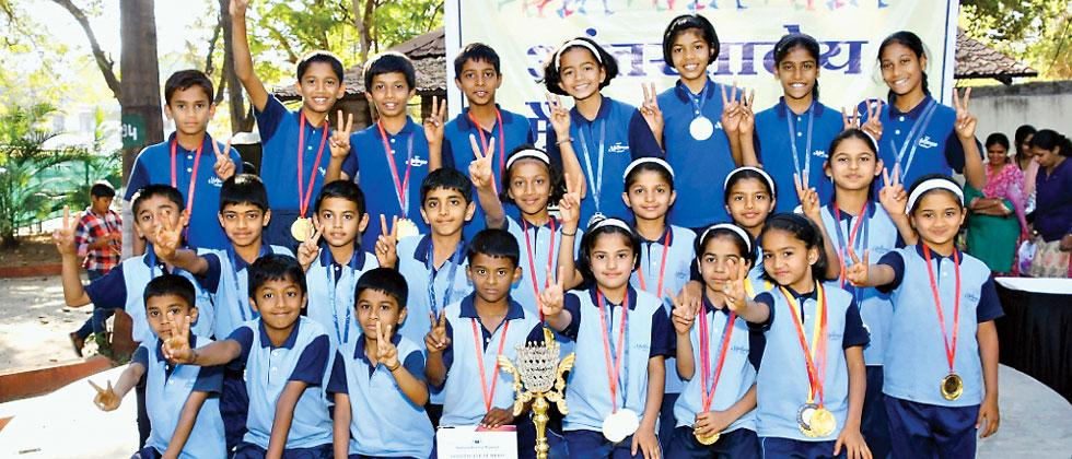 Students of Muktangan English Medium School pose for a group photo after emerging overall champions