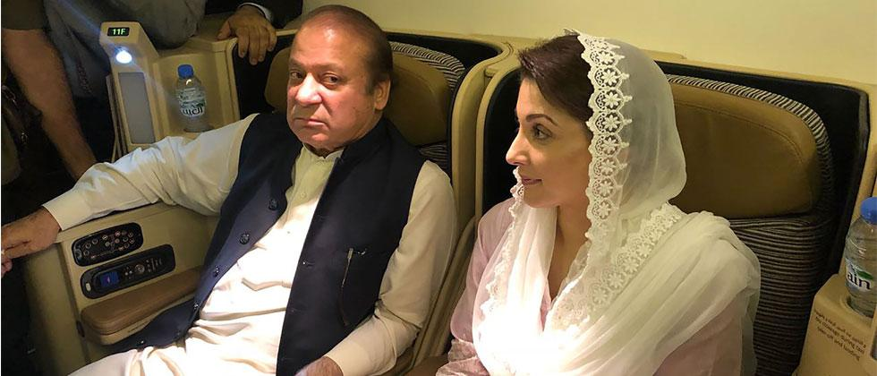 Handout photograph released by Pakistan Muslim League Nawaz (PML-N) party on July 14, 2018, shows former prime minister Nawaz Sharif (L) and his daughter Maryam Nawaz sitting on a plane after their arrival in Lahore. ML-N/HO/AFP