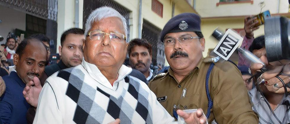 RJD supremo Lalu Prasad Yadav escorted by police officials after being convicted by the special CBI court in fodder scam case, in Ranchi on Saturday. PTI Photo