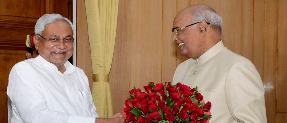 Bihar Chief Minister Nitish Kumar greets Governor Ram Nath Kovind on being announced as NDAs presidential candidate, in Patna on Monday. PTI Photo