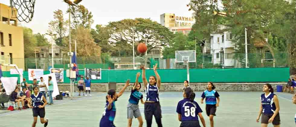 tough fight: Players of Deccan Gymkhana 'A' in action against Chonde Patil Academy (in light blue) at the Deccan Gymkhana basketball court on Saturday.