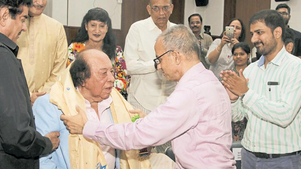 Roshan Taneja being presented with a designed-for the-occasion silk stole by FTII Director Bhupendra Kainthola on Saturday.