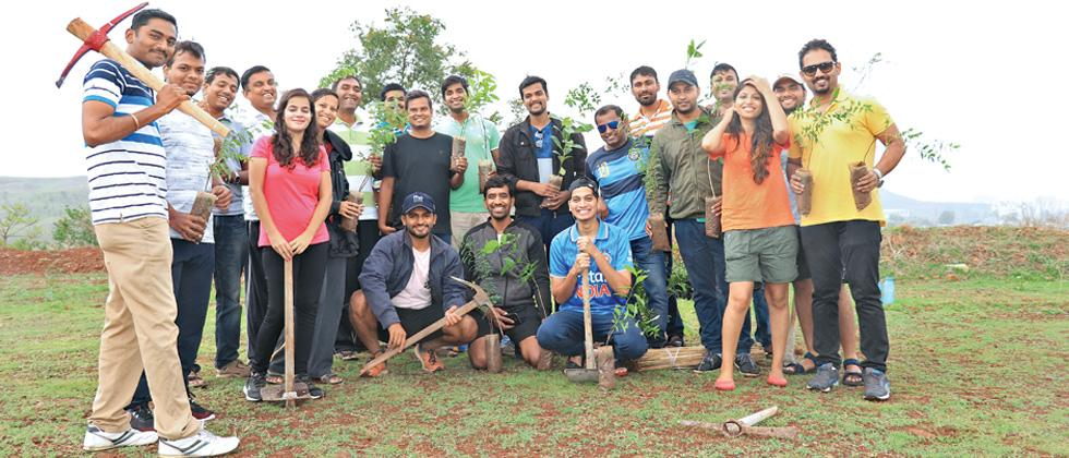 Members of 'GreenITians' after one of their plantation drives in Pune.