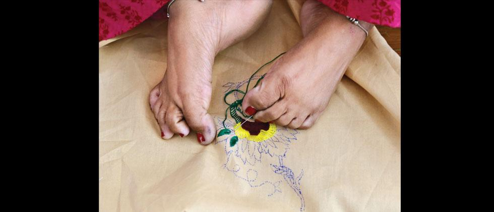 Disabled women doing embroidery. Various challenged people participated in the West Zone Regional Abilympics held in Pune