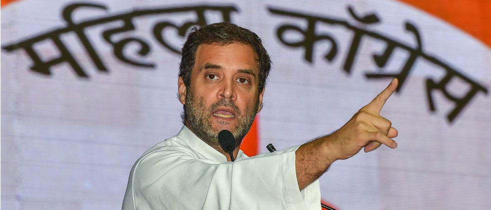 Congress President Rahul Gandhi addresses his supporters during 'Mahila Adhikar Sammelan', in New Delhi on Tuesday, Aug 07, 2018. Kamal Kishore/PTI