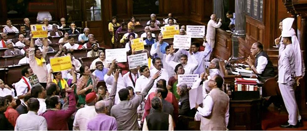 Opposition members protest in the well of the Rajya Sabha in New Delhi on Thursday. PTI Photo/TV Grab