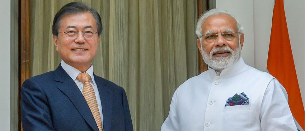 Prime Minister Narendra Modi and South Korean President Moon Jae-in shake hands prior to a meeting at Hyderabad House, in New Delhi on Tuesday, July 10, 2018. Kamal Singh/PTI