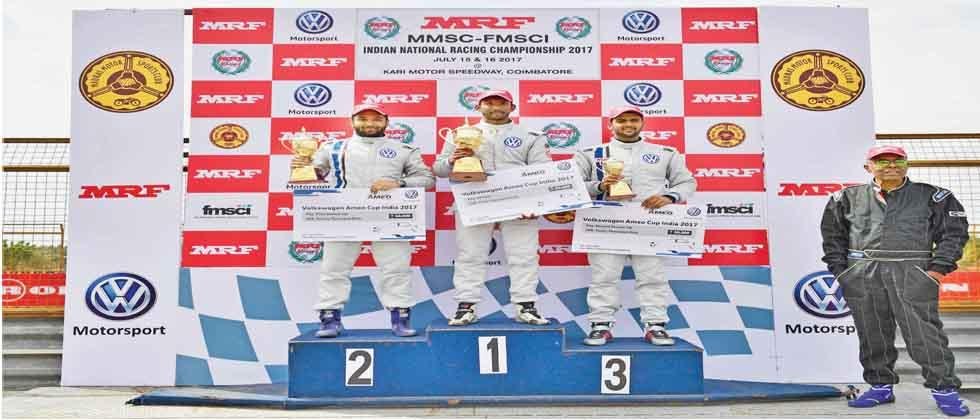 (From left) Karminder Pal, Sandeep Kumar and Dhruv Mohite, winners of Race 2 of the Volkswagen Ameo Cup pose on the podium at Kari Motor Speedway.