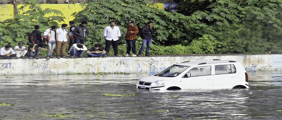 A car submerged in the Mutha river in Narayan Peth on Saturday.