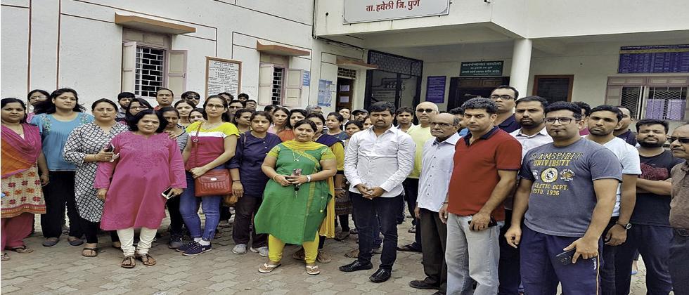 Wagholi residents outside the grampanchayat office.