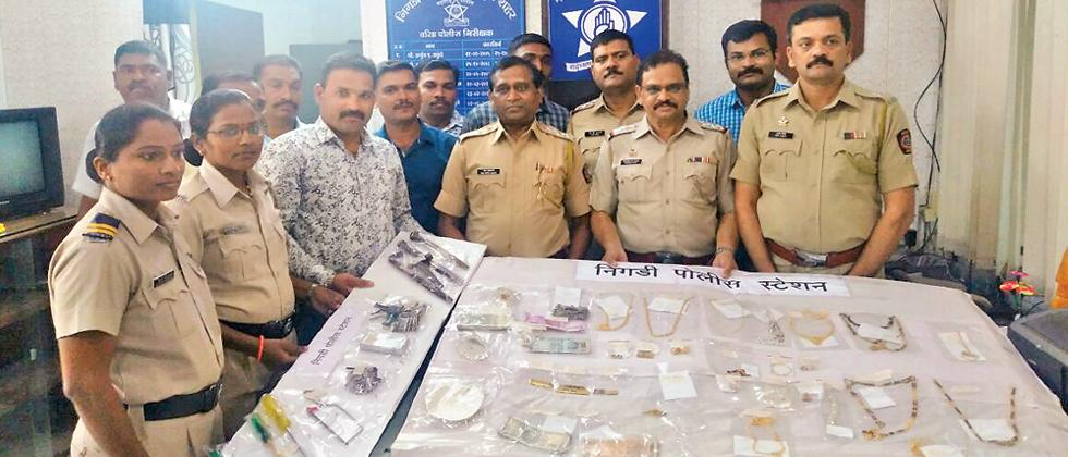 Officials of Nigdi police with break-in instruments and stolen goods recovered from the three accused.