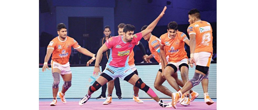 Raider Pawan Kumar of Jaipur Pink Panthers in action during their match against Puneri Paltan in the Pro Kabaddi League Season 5 match at Sawai Mansingh Stadium in Jaipur on Sunday.