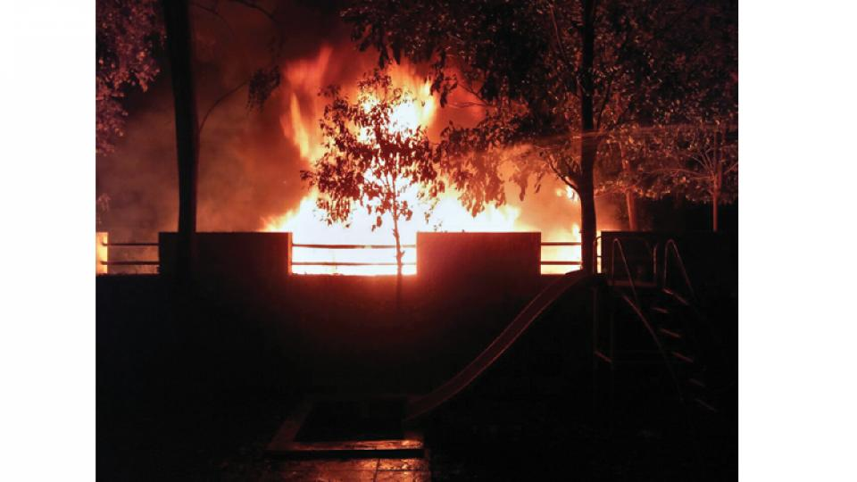 A fire broke out at an open space near Navle Bridge on Sinhgad Road on Thursday night.