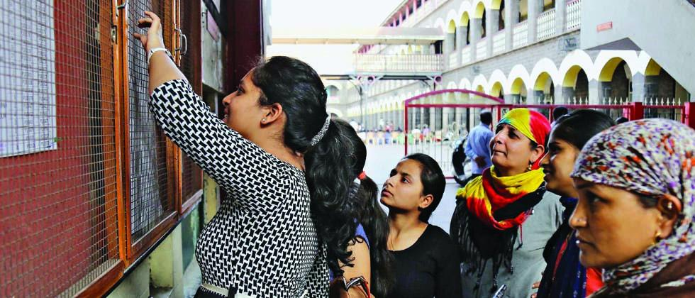 Students confirm their hall ticket numbers for the forthcoming  HSC examination at a school in the city on Tuesday.