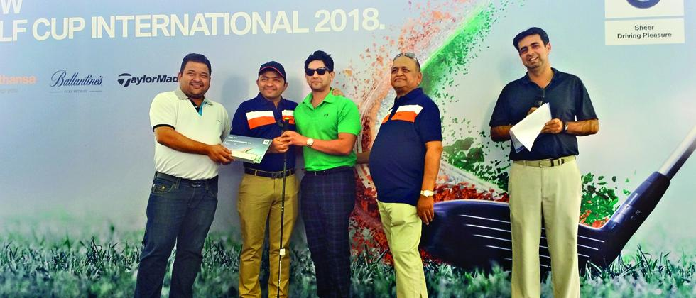 Chirag Shah (right) receives his winner's prize from Vishal Agarwal (centre) MD of Bavaria Motors.
