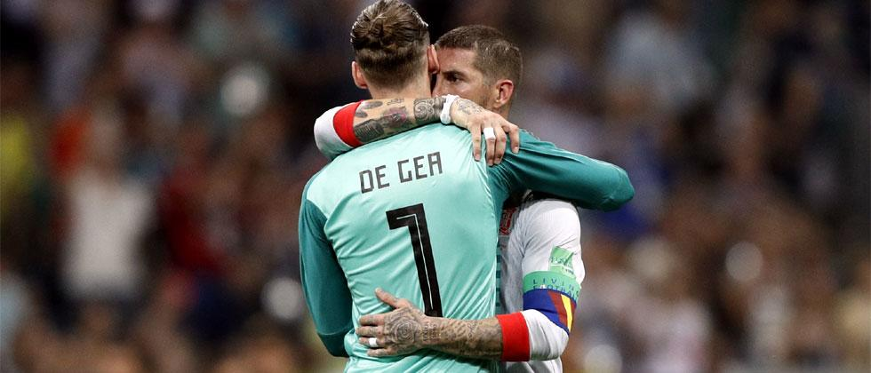 Spain's defender Sergio Ramos hugs Spain's goalkeeper David De Gea at the end of the Russia 2018 World Cup Group B football match between Portugal and Spain. Adrian Dennis/AFP