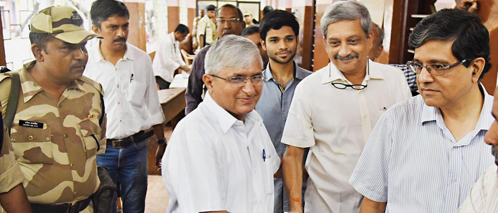 Goa Suraksha Manch leader Subhash Velingkar greets Goa Chief Minister Manohar Parrikar during the voting for the Panaji assembly bypoll recently.