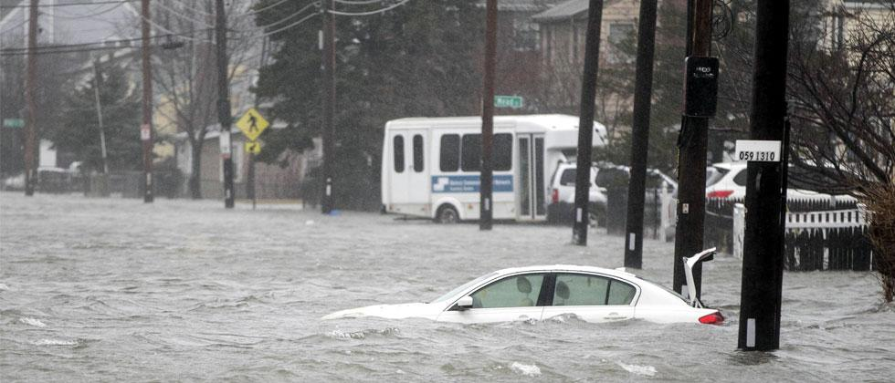 A flooded car sits in Hough's Neck due to a strong coastal storm on March 2, 2018 in Quincy, Massachusetts. A nor'easter hit the east coast on Friday, bringing coastal flooding, heavy snow and strong winds to the area. Photo-Scott Eisen/Getty Images/AFP