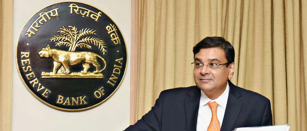 Reserve Bank of India Governor Urjit Patel arrives for a news conference at the bank's head office in Mumbai on Wednesday