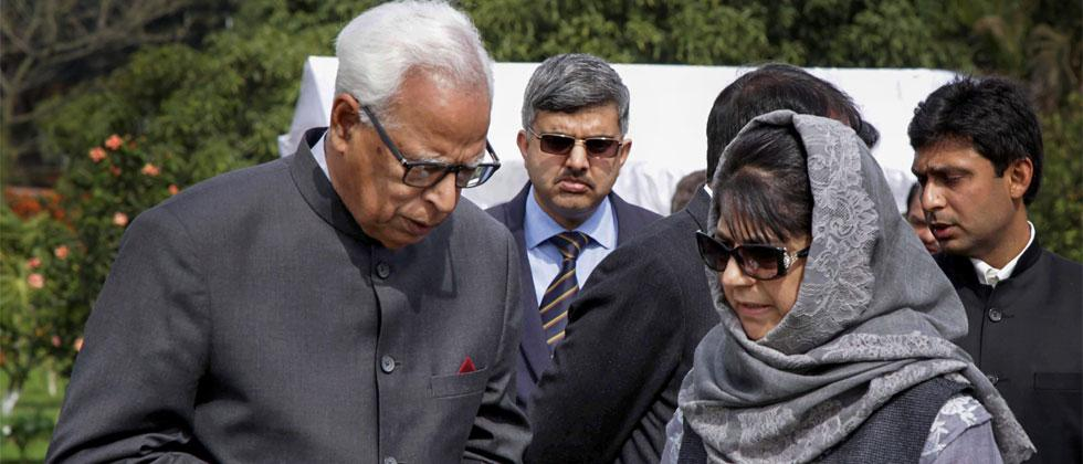 File photo dated February 17, 2017, J&K Governor NN Vohra is seen with Mehbooba Mufti after a swearing-in ceremony at the Governor House in Jammu. PTI Photo