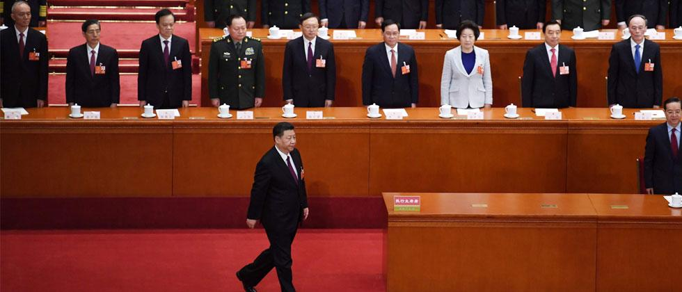 China's President Xi Jinping walks to a podium to swear an oath after being elected for a second term at the Great Hall of the People in Beijing on March 17, 2018. Photo/Grey Baker/AFP