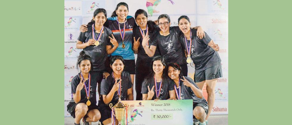Capgemini team members pose for a picture after defeating Infosys to clinch the Corporate Volleyball Championship