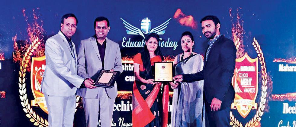 Proud moment:  Clara Global School receiving the award for 'Top Upcoming CBSE School' in Maharashtra.