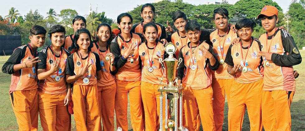 Players of Divine Stars pose with their trophy on Saturday