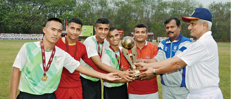 Cadets Training Wing (CTW) team members receive trophy after winning Inter College Football tournament.