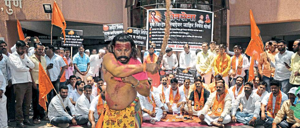 A potraj whips himself during the protest by Shiv Sena members against the NCP and MP Supriya Sule outside the ZP office