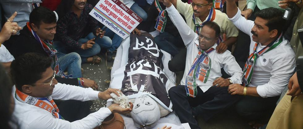 Maharashtra Navnirman Sena (MNS) supporters, with an effigy representing 'Achchhe Din', raise slogans at a protest during the 'Bharat Bandh', called against fuel price hike and depreciation of the rupee, in Mumbai on Monday.
