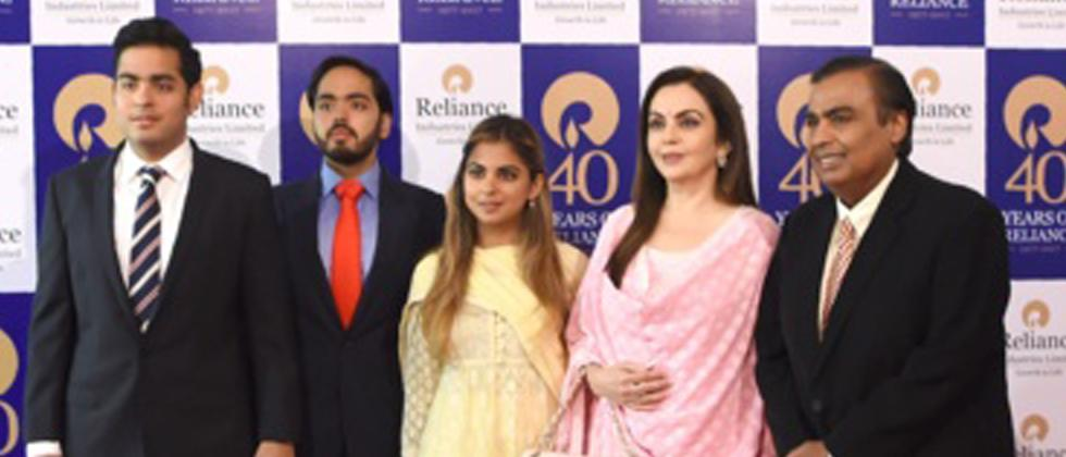 Mukesh Ambani (R) and his wife Nita Ambani (2R) pose with their children (L-C) Akash Ambani, Anant Ambani and Isha Ambani as they arrive for the company's 40th AGM in Mumbai on July 21, 2017
