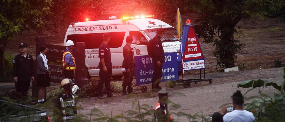 An ambulance leave the Tham Luang cave area after divers evacuated some of the 12 boys and their coach trapped at the cave in Khun Nam Nang Non Forest Park in the Mae Sai district of Chiang Rai province on Sunday.