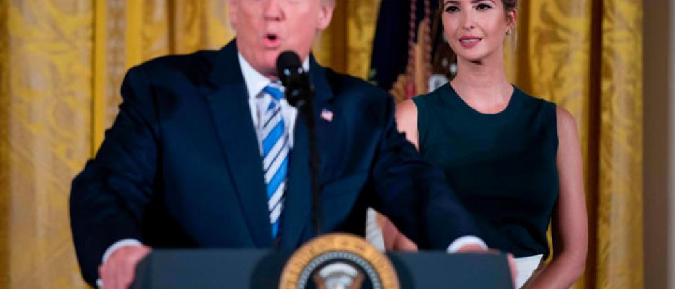 US President Donald Trump speaks next to his daughter Ivanka during an event with small businesses at the White House in Washington, DC, on August 1, 2017. / AFP PHOTO
