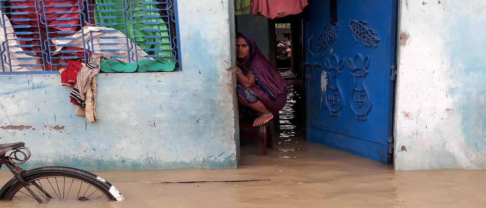 A Nepalese resident looks out from her inundated home at floodwaters at Janakpur, some 300kms south-east of Kathmandu on August 13, 2017.