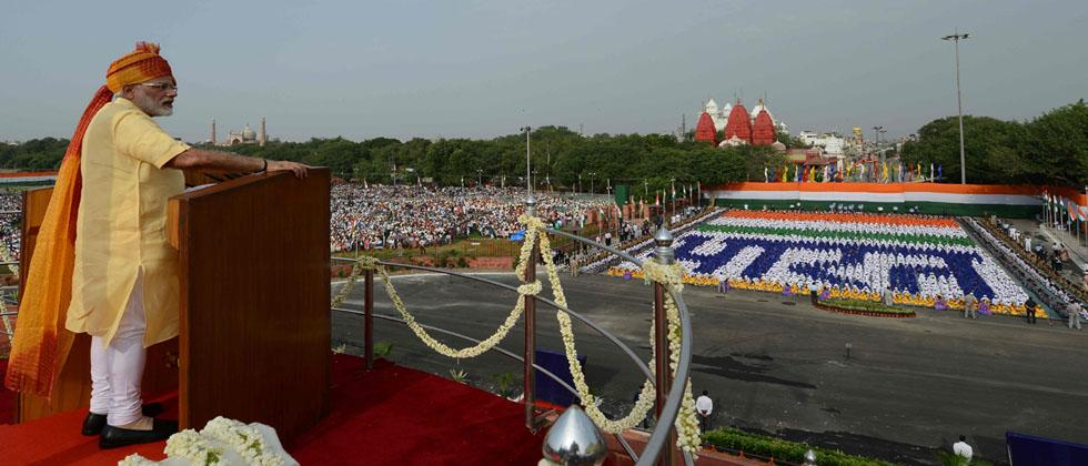 Prime Minister Narendra Modi delivers his speech as schoolchildren (background) sit in formation forming Hindi script that reads 'Bharat' (India) during the country's 71st Independence Day celebrations, which marks the 70th anniversary of the end of Briti