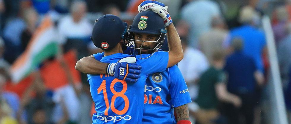 India's Kannanur Lokesh Rahul (R) and India's Virat Kohli (L) celebrate their victory during the international Twenty20 cricket match between England and India at Old Trafford cricket ground in Manchester northwest England on Tuesday.